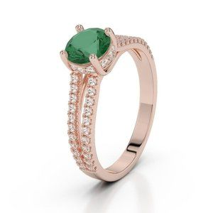 4.25 Carats round brilliant cut emerald and diamon